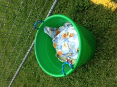 Bucket of mini tarps (photo: Rebecca Webster)